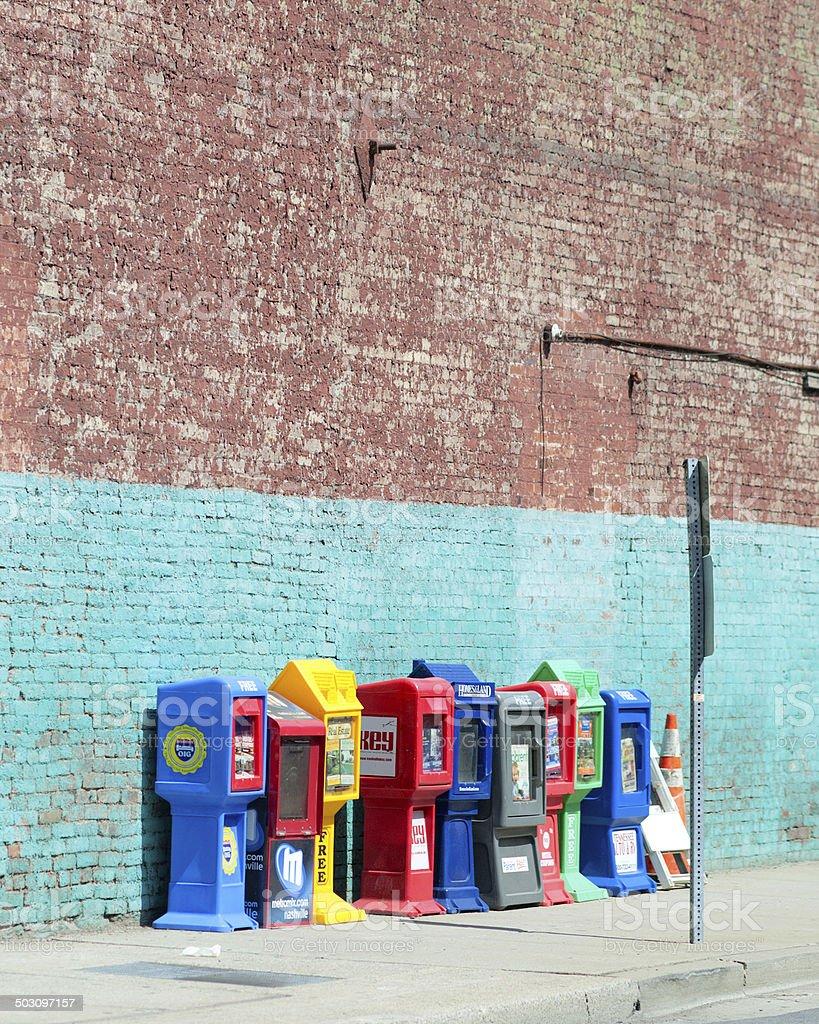 Colorful news racks stock photo