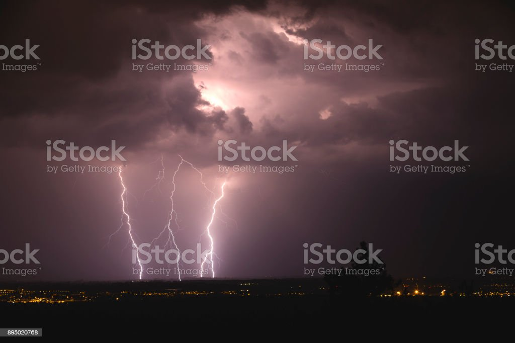 Night shot of dramatic skies during summer storm, Italy