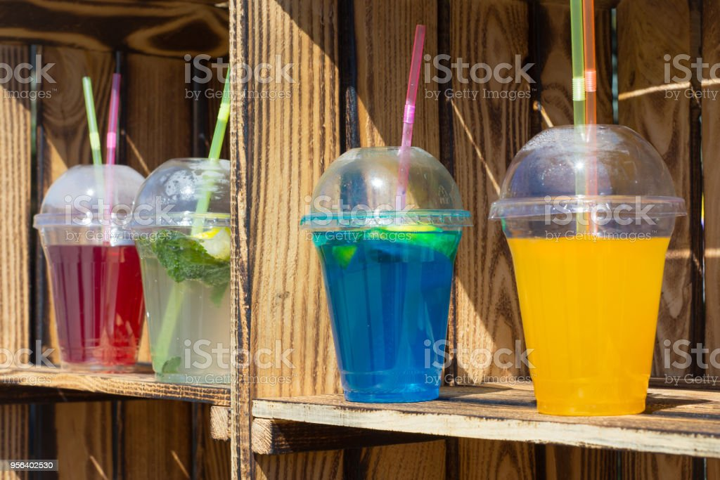colorful non-alcoholic cold cocktails in disposable cups stock photo