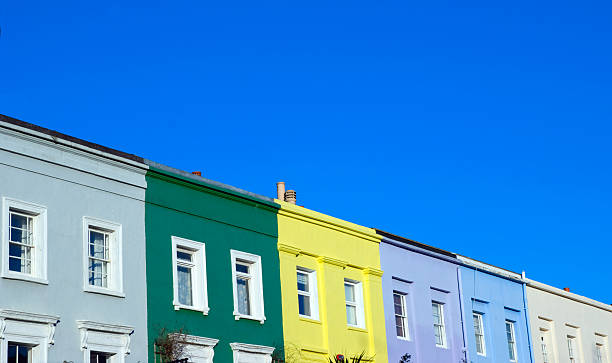 colorful notting hill houses under a blue sky - terraced houses stock photos and pictures