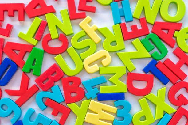 Colorful numbers and letters as background on the topic of learning and school education illiteracy stock pictures, royalty-free photos & images