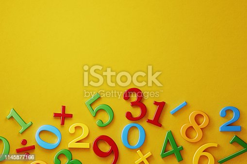 Colorful numbers on yellow background. Horizontal composition with  copy space. Directly above.