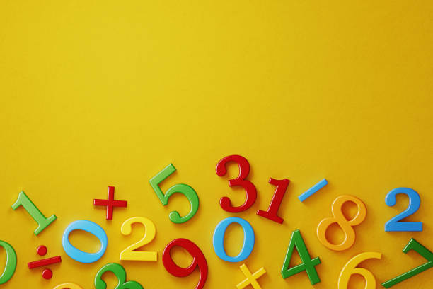 Colorful Numbers On Yellow Background Colorful numbers on yellow background. Horizontal composition with  copy space. Directly above. minus sign stock pictures, royalty-free photos & images