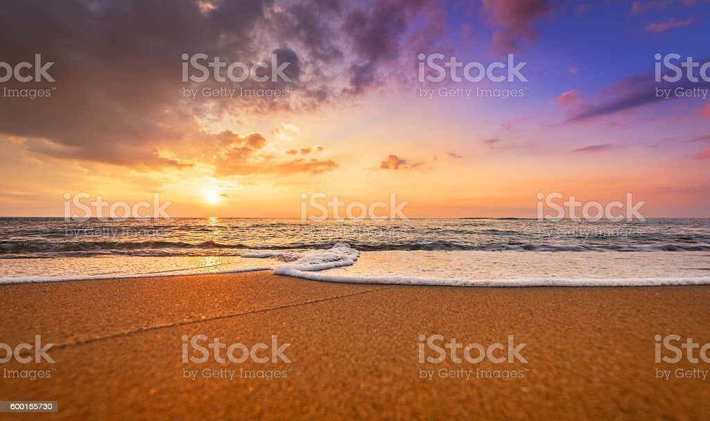 Colorful ocean beach sunrise. stock photo