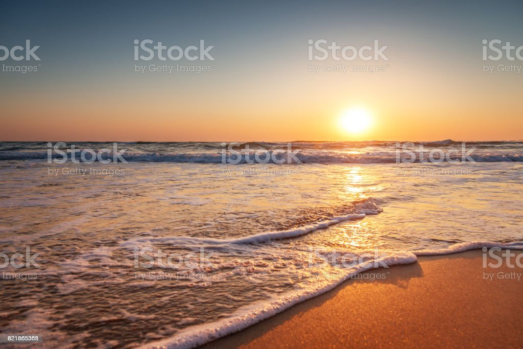 Colorful ocean beach sunrise stock photo