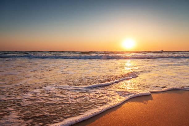 färgglada ocean beach soluppgång - spain solar bildbanksfoton och bilder