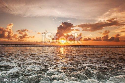 istock Colorful ocean beach sunset 1300791079