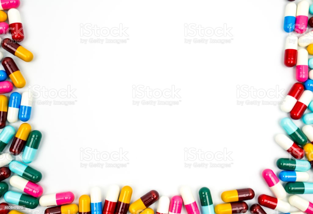 Colorful of antibiotic capsules pills frame isolated on white background with copy space. Drug resistance concept. Antibiotics drug use with reasonable and global healthcare concept. stock photo