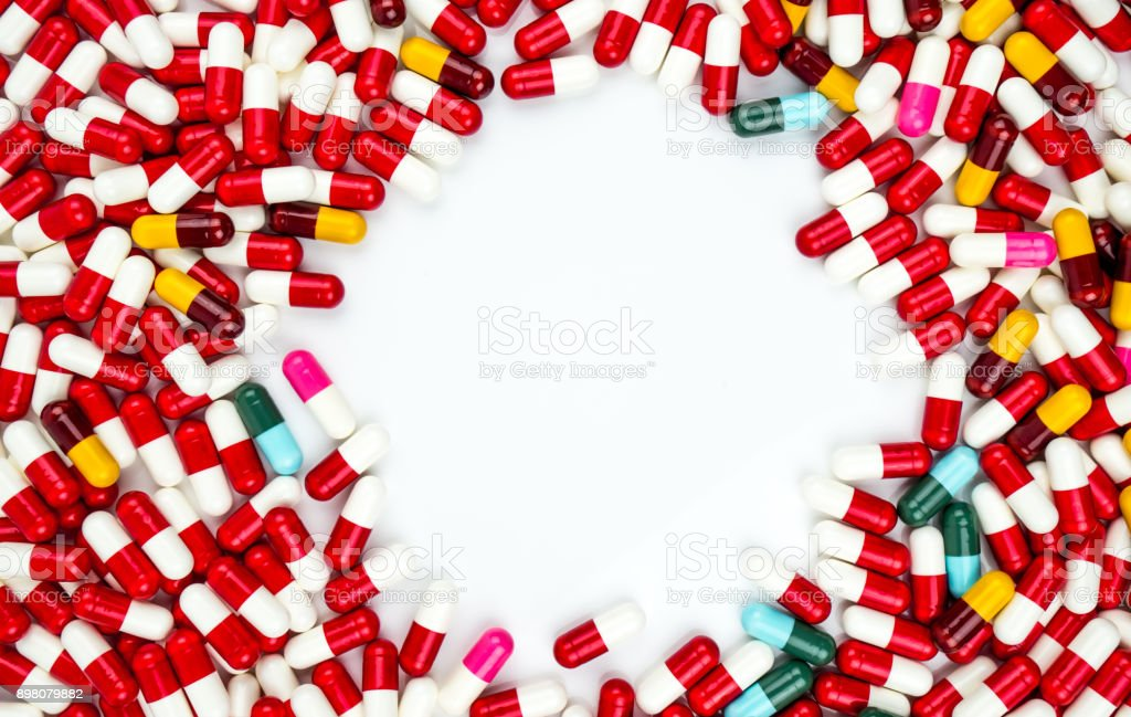Colorful of antibiotic capsules pills isolated on white background with copy space. Drug resistance concept. Antibiotics drug use with reasonable and global healthcare concept. stock photo