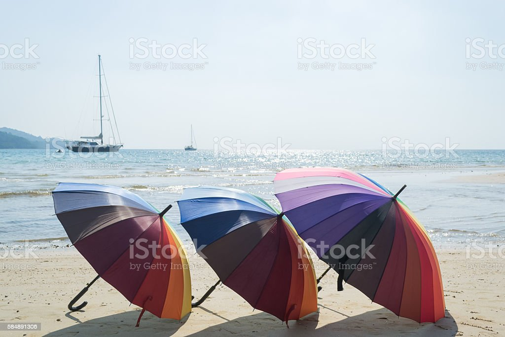 colorful of beach umbrella with sky and beach background stock photo