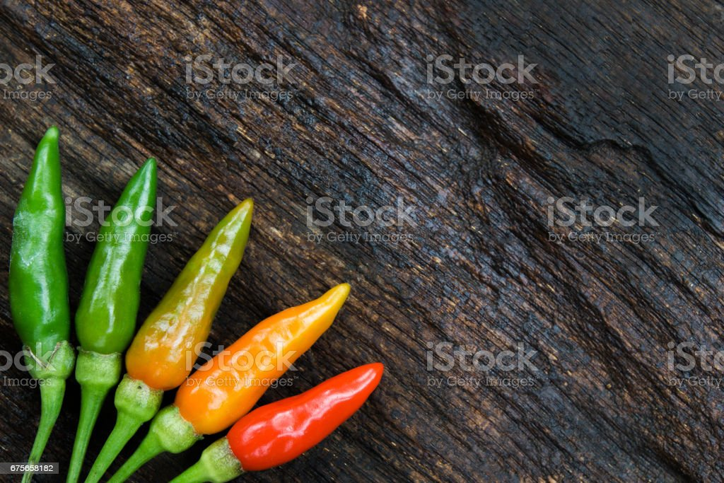 colorful of chilli on dark wood royalty-free stock photo