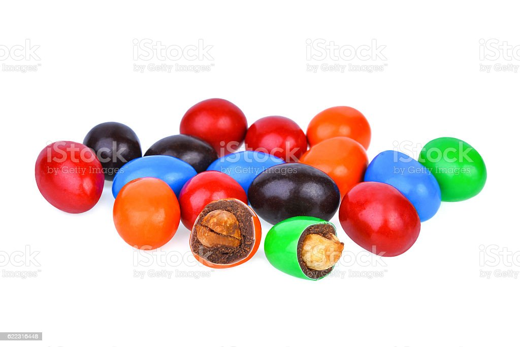 Colorful of chocolate candies stuffed with nuts isolated on whit stock photo