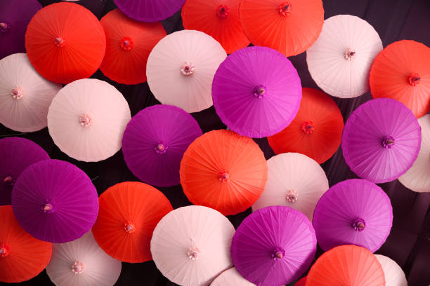 colorful of hand made umbrella hang on ceiling stock photo