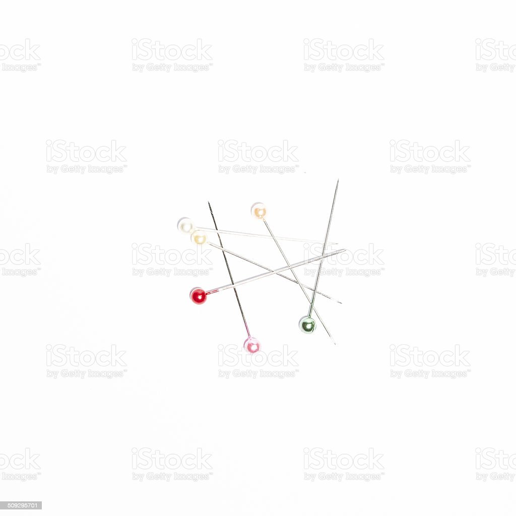 colorful of quilting pins on white background stock photo