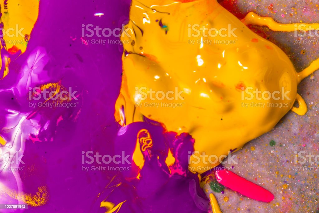 colorful of screen printing ink dropped on the ground made an...