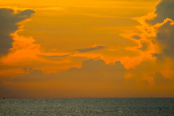 colorful of sunset sky on cloud fishing boat on island and sea stock photo