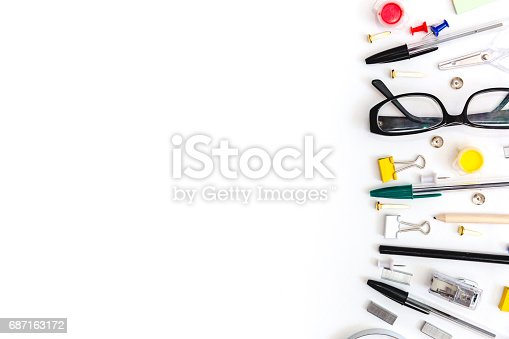 istock Colorful office desk with a pencins and other equipment, white table, flat lay, copy space 687163172