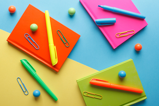 Colorful school or office supplies with balls.