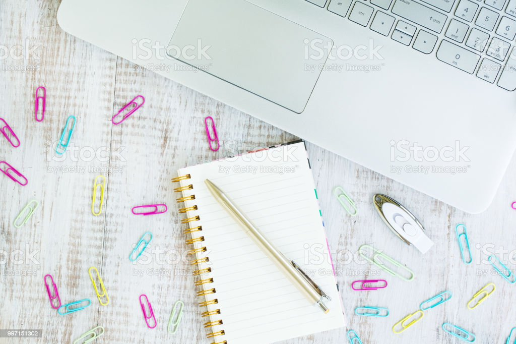 Colorful Office Work Desk Flat Lay From Above with Laptop Computer stock photo