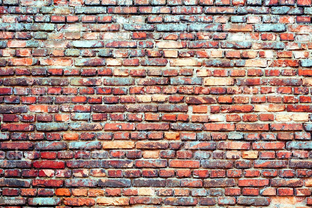Colorful old brick wall stock photo