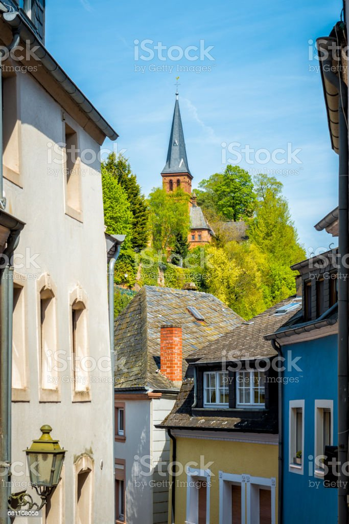 colorful old buildings of a street at City Saarburg royalty-free stock photo