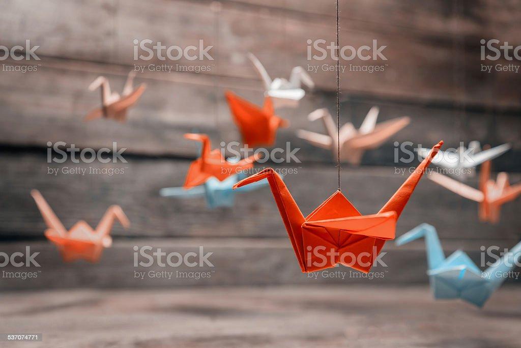 Colorful origami paper cranes stock photo