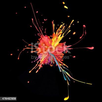 istock Colorful paint splashing on black. 476462939