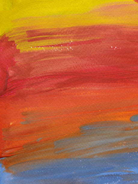 Colorful paint texture of kids painting looks like rainbow or sunset sky stock photo