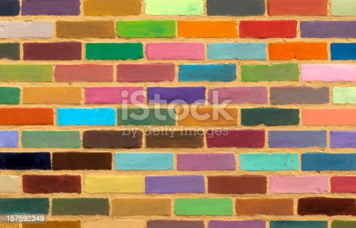 A background, pattern or texture made from a multi-colored painted brick wall.
