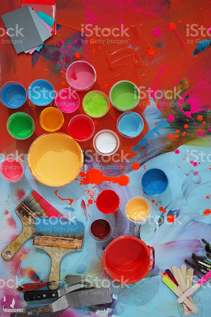 Colorful Painted Canvas With Brushes and Paint Cans stock photo
