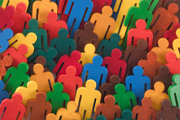 Colorful painted group of people figures stock photo