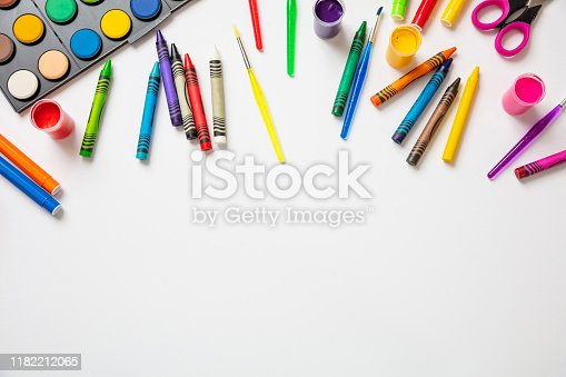 Creative kids. Colorful paints on white color background, top view, copy space