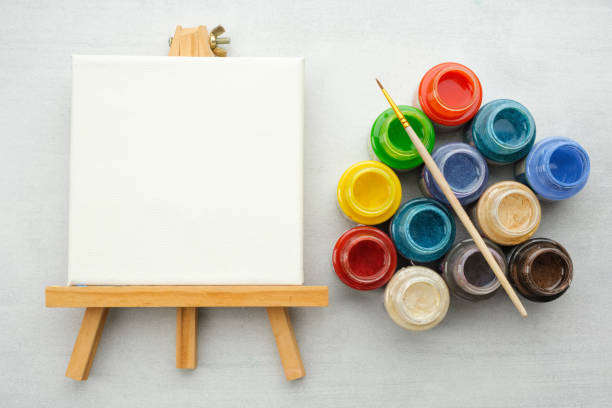 colorful paints with paint brush and canvas on the easels, top view. - tempera painting stock pictures, royalty-free photos & images
