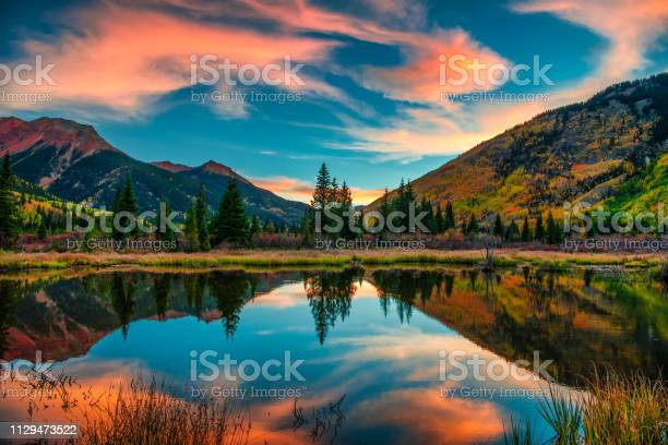 Photo of Colorful Panoramic Mountain View at Sunrise
