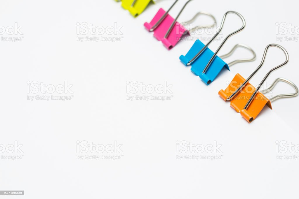 Colorful paper clips isolated on white background, Copy space. stock photo