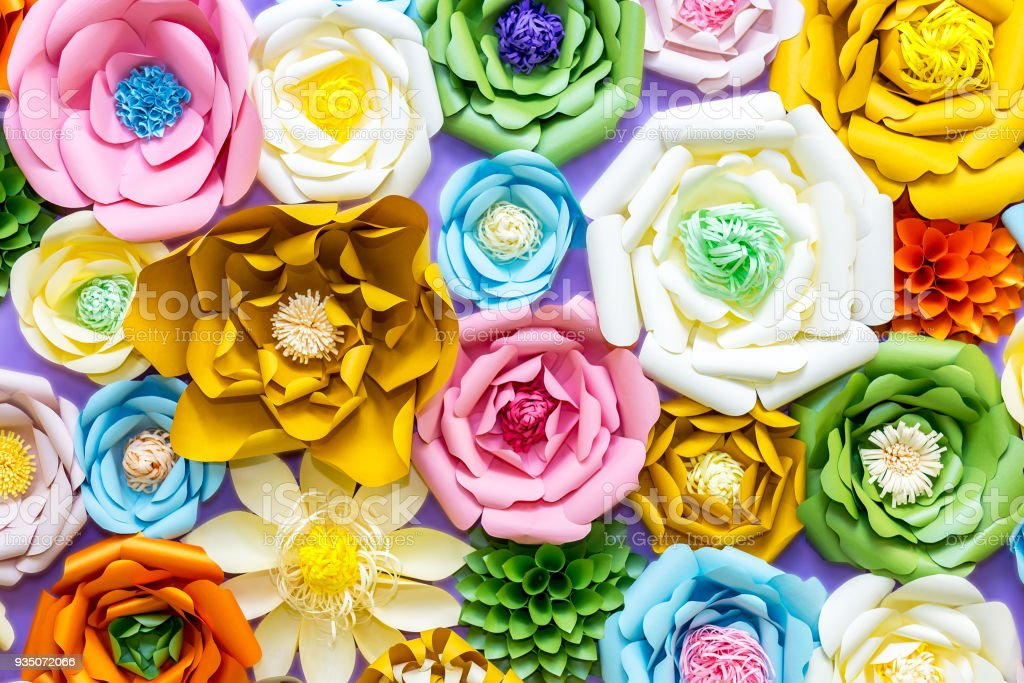 Colorful paper flowers on wall handmade artificial floral decoration colorful paper flowers on wall handmade artificial floral decoration spring abstract beautiful background and mightylinksfo