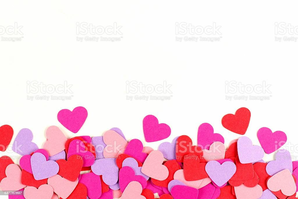 Colorful paper hearts border stock photo