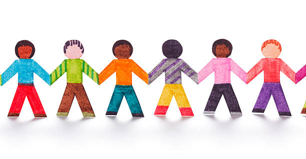 Colorful paper people in a line stock photo