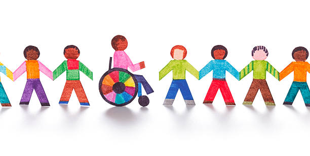 Colorful paper people with wheelchair stock photo