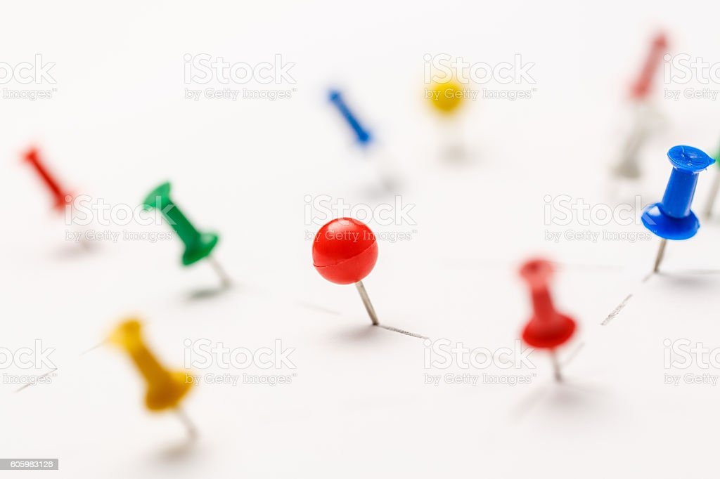 Colorful paper pins attached stock photo