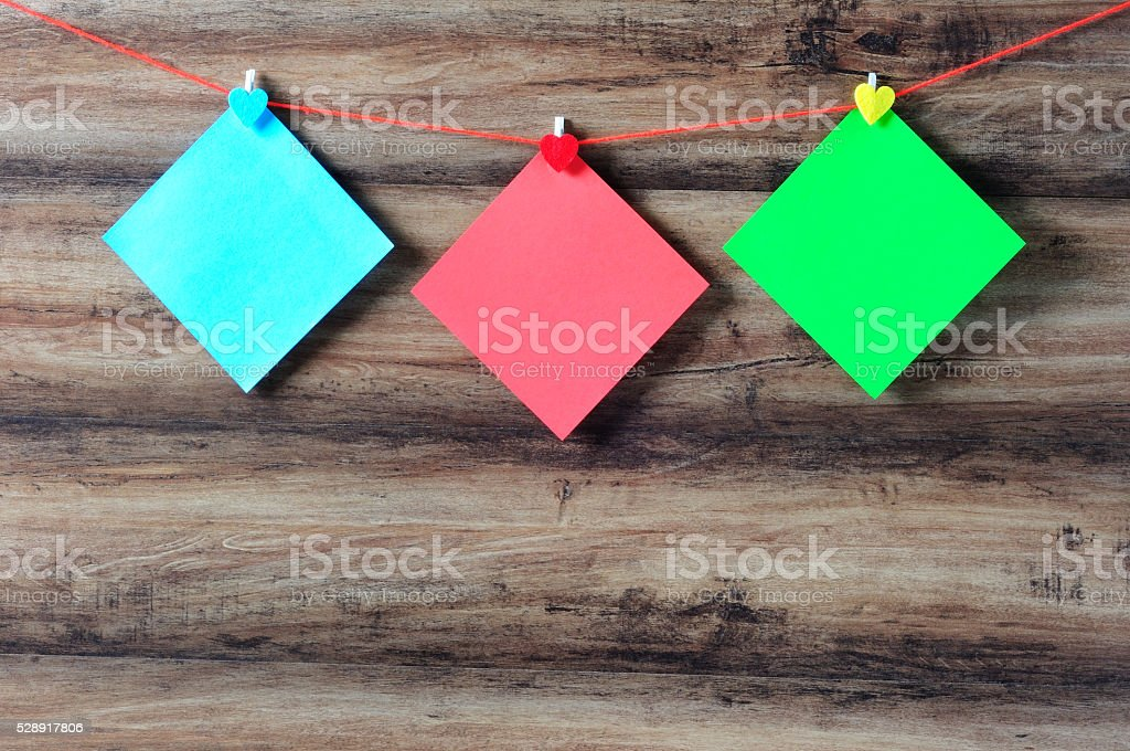 Colorful paper with clothespin hanging on a string stock photo