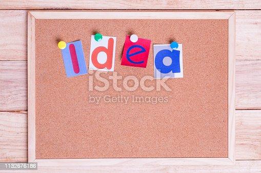 istock Colorful paper word IDEA on the cork board on table . Idea Concept. 1132676186
