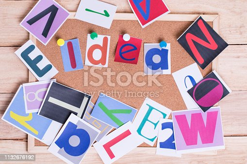 istock Colorful paper word IDEA on the cork board on table . Idea Concept. 1132676192
