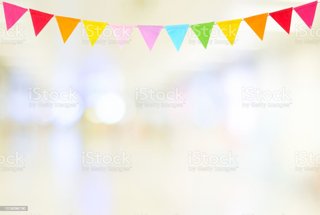 Colorful party flags hanging on blur abstract background, birthday, anniversary, celebrate event, festival greeting card background stock photo