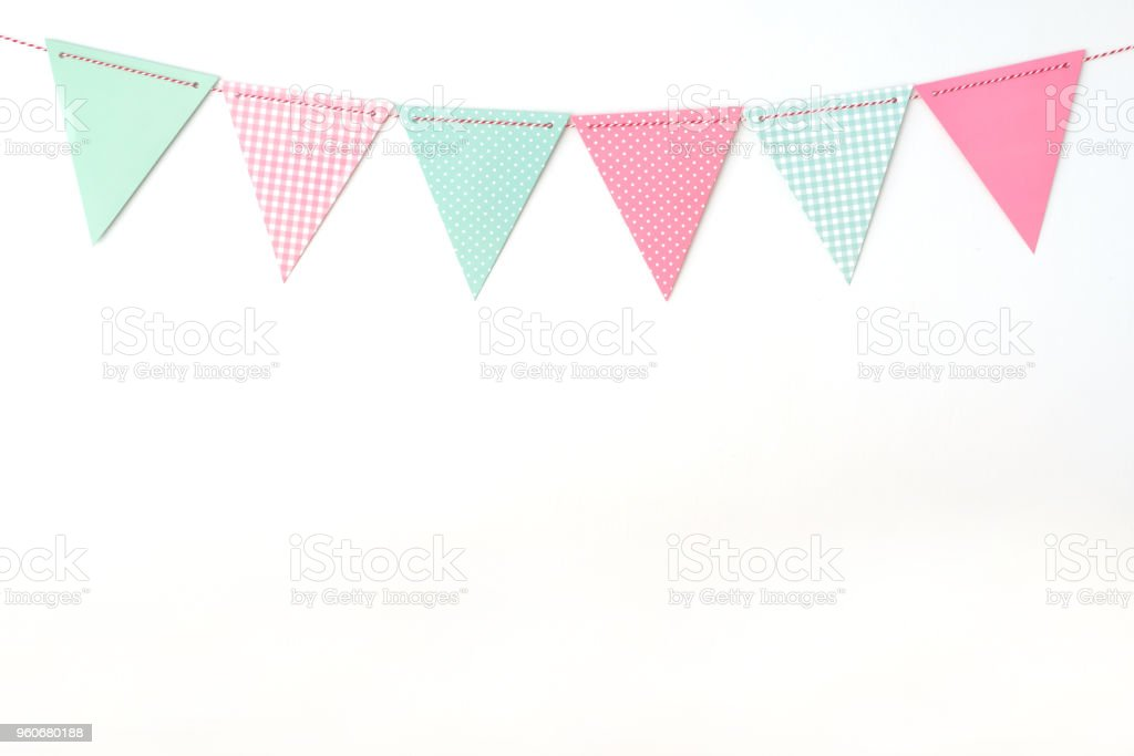 Colorful party flags hanging on white wall  background, birthday, anniversary, celebrate event, festival greeting card background stock photo