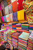 Colourful pashmina shawls and scarves for sale at Grand Bazaar market in Istanbul, Turkey