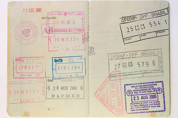 colorful passport stamps - rubber stamp texture stock photos and pictures