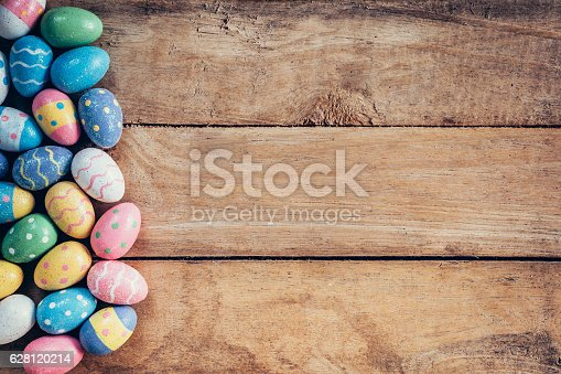 istock Colorful pastel easter eggs on wooden background with space. Vin 628120214
