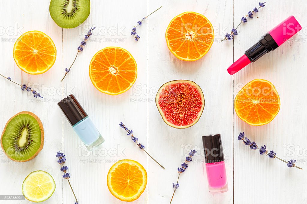 Colorful pattern made of fruits top view with makeup foto royalty-free