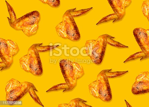 istock Colorful pattern of chicken wings roasted on bbq. Yellow background 1172010238